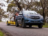 Mazda BT-50 towing excavator