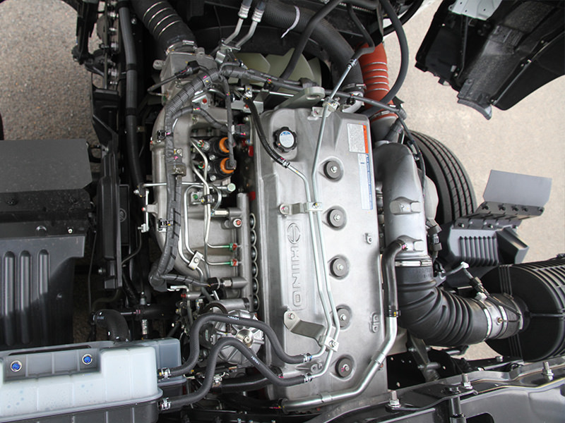 Hino's A09C engine has been considerably reworked with among other things, a new turbocharger and a swap from Bosch to Denso common-rail fuel injection. The 350 hp rating is a gritty performer well-matched to Hino's nine-speed manual shifter.