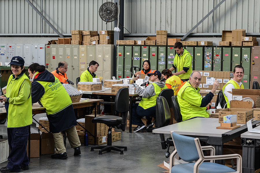 Supported workers in the packaging and assembly warehouse